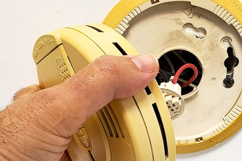 Why is my smoke detector beeping and how to stop it?